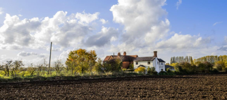 UK farmhouse surrounded by farmland