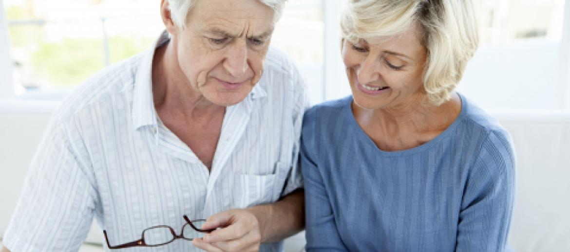 Elderly Couple looking a important documents