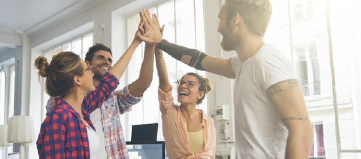 Entrepreneurs giving high-fives to each other