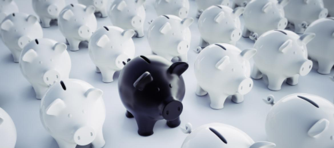 Black Piggy Bank in a group of white piggy banks