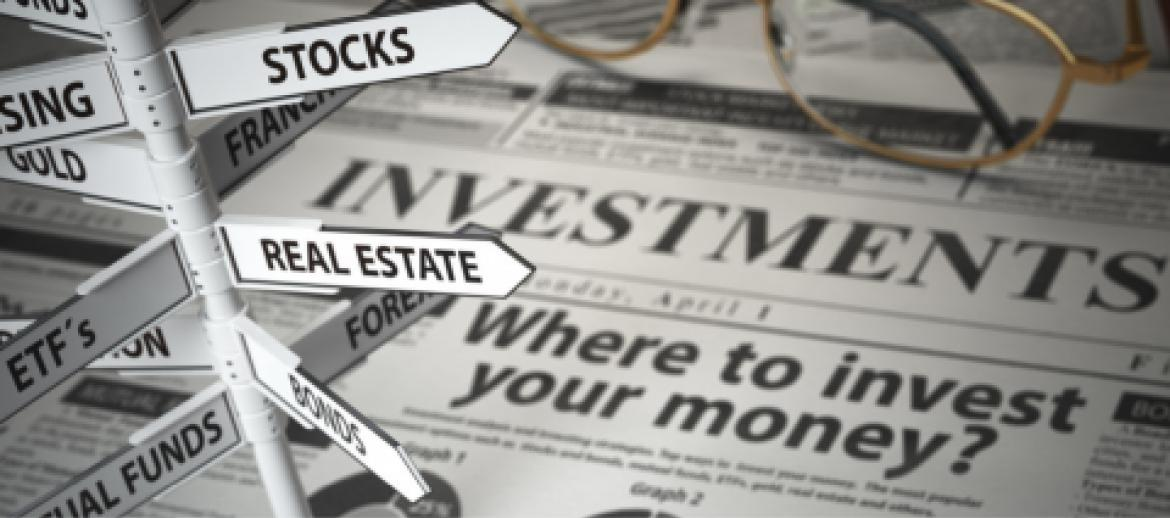 Investments written on a newspaper