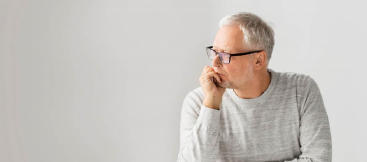 Middle aged man looking worried