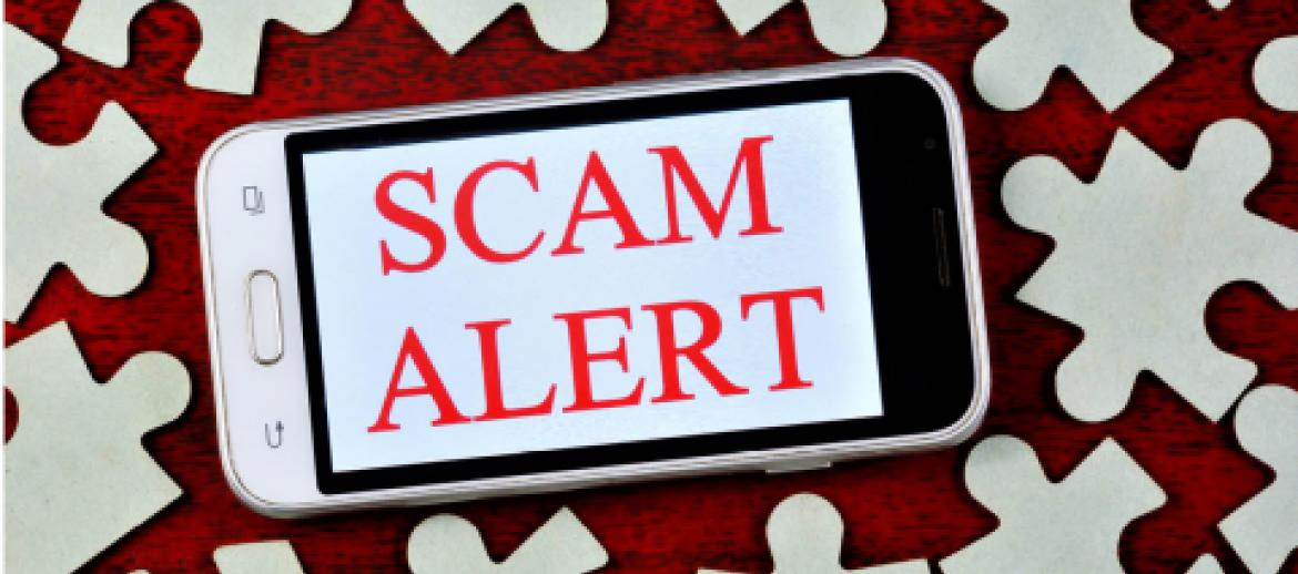 Scam alert on mobile phone