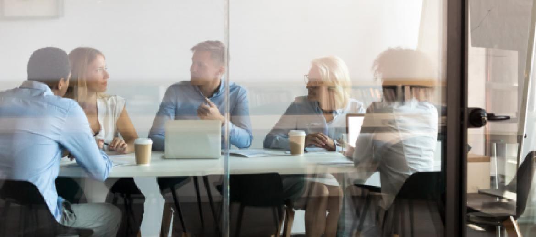 colleagues-in-meeting-room