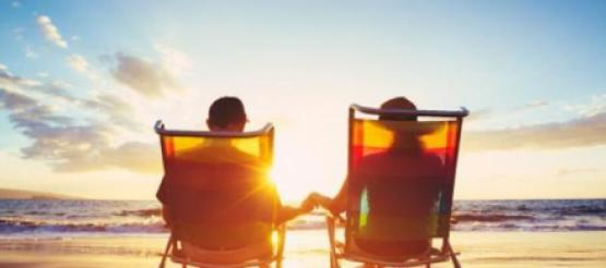Retired couple sitting on deck chairs