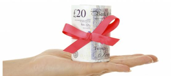 Twenty Pound Notes given as a gift wrapped in ribbon