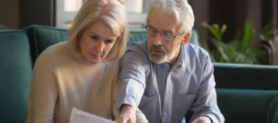 Retired couple looking at pension documents together