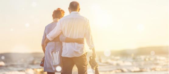Married Couple walking along a beach
