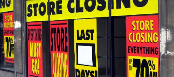 Store closing signs on shop front