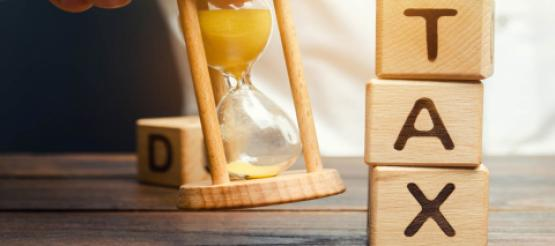 Tax in blocks with sand timer running out