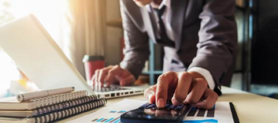 Business man calculating cash flow