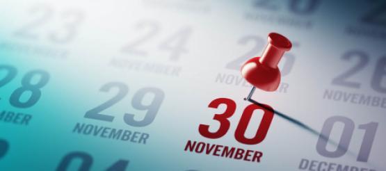 red pin on stuck on 30 November on calendar