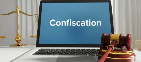 Confiscation typed on laptop