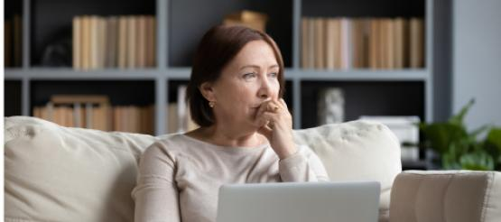 Middle aged woman looking at Pension information