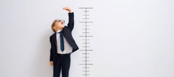 Boy standing next to measurement