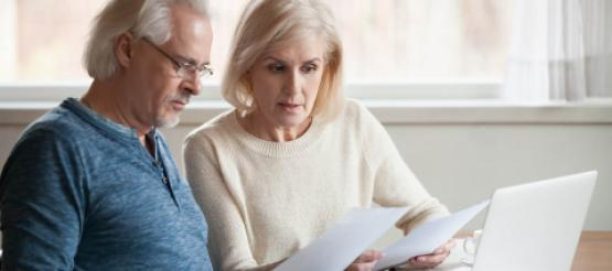 Retired Couple looking at finances