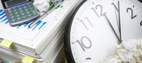 financial records and a clock