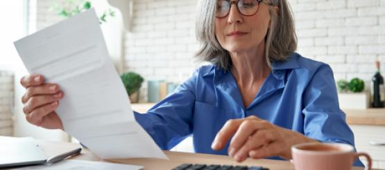 65 year old woman calculating her pension