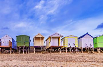 Colourful beach huts in the UK