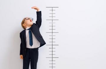 Boy standing next to measurement
