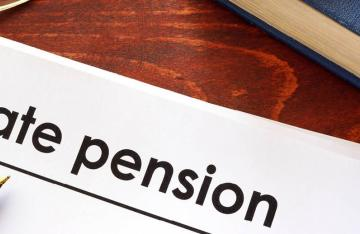 State Pension written on paper with pen