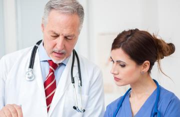 Retiring Doctor talking to Nurse