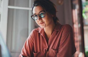 Woman employee working on laptop