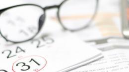 Calendar, glasses and calculator